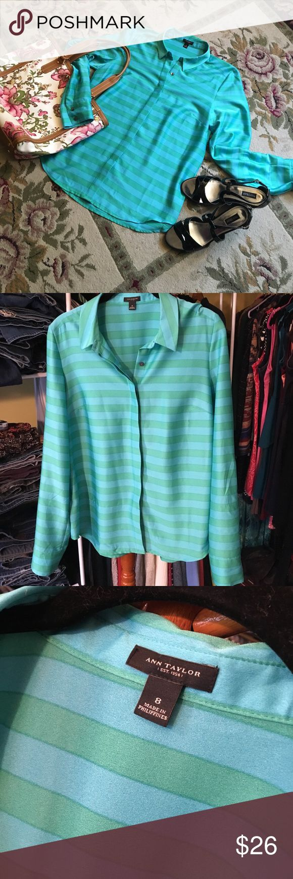 """Ann Taylor Blouse BNWOT Ann Taylor blouse. Hidden buttons. Bust darts and button cuffs. Button and strap to hold sleeves at 3/4 length if desired. 18"""" pit to pit. 25"""" shoulder to hem. Talbots purse and White House Black Market shoes sold separately. Ann Taylor Tops Blouses"""