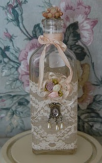make a pretty altered bottle. I love the ribbons, lace, the flowers, & the embellishment.
