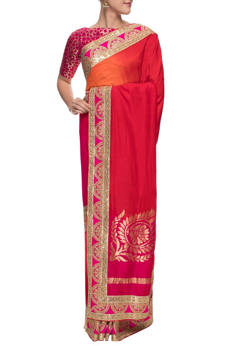 ANITA KANWAL A shaded red and pink benarasi sari with gota border $411 A shaded red and pink benarasi monga silk sari enhanced with gota border. It features a statement gold motif on the border. It comes with a blouse piece and has a relaxed fit.