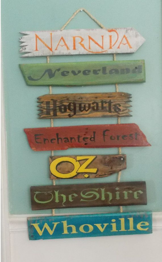 This custom made to order wall hanging consists of 7 hand-painted reclaimed wood signs. Featuring classic story book titles and make believe locations, this sign is perfect for an outdoor garden, kids bedrooms, play rooms, or library. The signs are attached to rope for easy hanging, they can also be sent without the rope so they can be attached to a sign post. -The standard set includes the following 7 names; Narnia, Hogwarts, Mr. McGregor's Garden, Hundred Acre Wood, Neverland, The Shire…