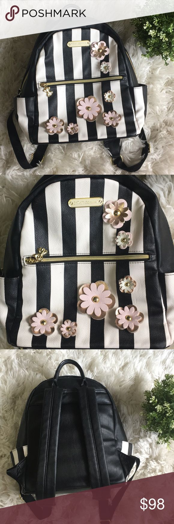 """Betsey Johnson backpack Betsey Johnson faux leather striped/floral black and ivory midsize backpack. Interior features 1 zip pocket, 1 large slip pocket & 1 key finder. Exterior features gold hardware, zip pocket & 2 slip pockets. Rare find on Poshmark. In excellent condition! Pictures speak for themselves. Smoke and pet free home. 13"""" wide, 12"""" height, 5"""" depth, 4"""" long top handle, 13"""" L-18"""" L adjustable backpack straps. Reasonable offers✅ Betsey Johnson Bags Backpacks"""