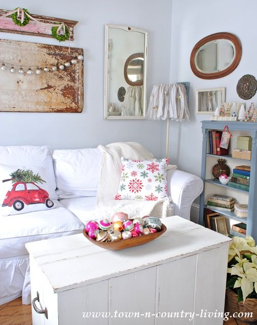 Farmhouse Family Room at Christmas ~ Love the Christmas pillow with red VW bug carrying the Christmas tree. ... lampshade has tiny butterflies on it.