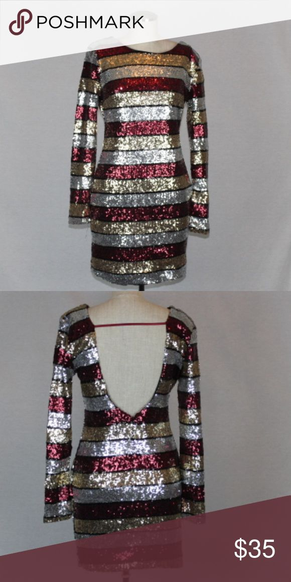 """NEW!!! Red, Gold, Silver BodyCon  Dress Own the night in this sparkly little number.  Red, gold, and silver sequin stripes make a bold statement. Scoop back, zipper opening.  100% Polyester. Dress is stretchy but PLEASE NOTE SIZES RUN SMALL.  L: Bust 34"""" Length 32""""  M: Bust 32"""" Length 31 3/4""""  S: Bust 29"""" Length 31"""" Dresses Mini"""