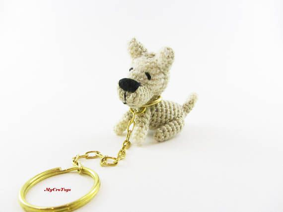 A funny crochet mini dog toy is perfect gift used as keychain. Original pocket gift. Lenght ~ 4 cm (1.6 inches); heigh 4.5 cm (1.8 inches). Keychain ring diameter = 2 cm (0.8 inches) Materials - acryl yarn and stuffed with polyester fibrefill. Can be washed in the washing machine. Delicat