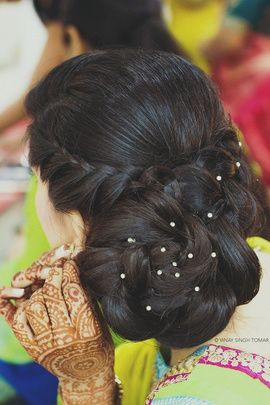 Mehndi Hairstyles - Braided Hairdo | WedMeGood A super cool braided hair bun with twisted hair fringes twirling all the way, with diamond studs on the bun! #wedmegood #mehendi #hairstyles