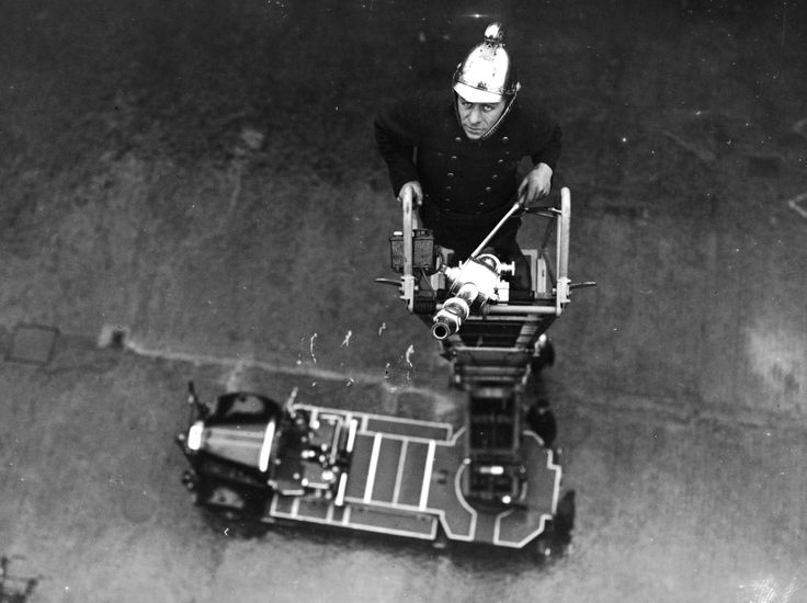 A fireman at the top of a new 100-foot (30,48 m) turntable ladder, which has just been delivered to the London Fire Brigade. (Photo by J. A. Hampton/Topical Press Agency/Getty Images). 26th February 1937