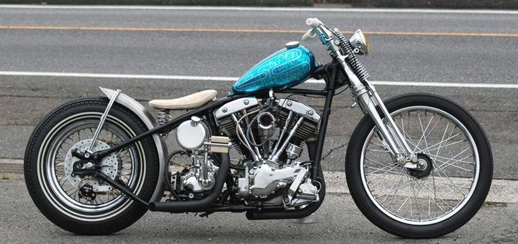 Harley Davidson ShovelHead Bobber Motorcycle With A Blue Peanut Tank