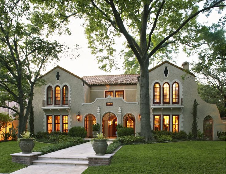 Alair Homes | Custom | Drexel | 3,400 sqft | 12 months | This Mediterranean style custom home features stucco siding, and a gated, triple-arched entry. The interior pallet consists of warm tones of beige, cream, and dark wood throughout.