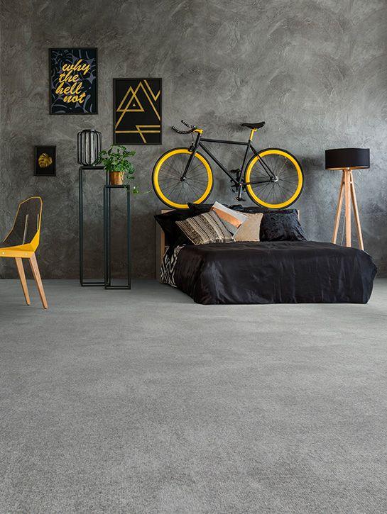 Myscrete | Collectie tapijt | Interfloor Tapijt Vinyl Project | Sfeerfoto industriële slaapkamer | De uitstraling van een stoere betonnen vloer met alle voordelen van tapijt, aangenaam zacht, comfortabel en geluiddempend