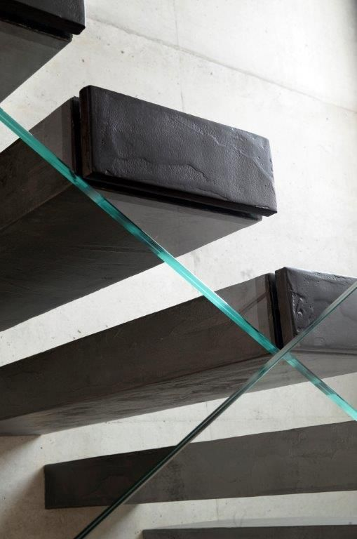 Materials were chosen with utmost care: steps are made of iron coated with dark gray spatulate resin (Gobbetto resin ((link)) Dega Art Spatolato Diorite) that gives the #staircase an unrefined, almost industrial look. #interbau #design #designforyourhouse #customized #highquality #art #modernart #madeinItaly