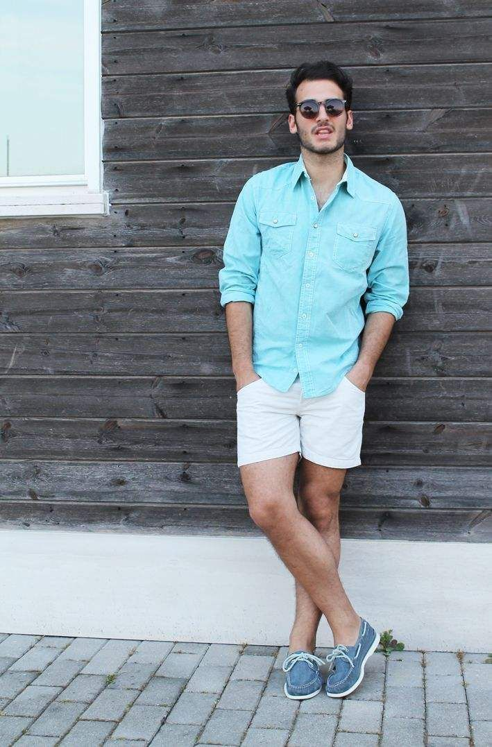 Shop this look for $118:  http://lookastic.com/men/looks/aquamarine-longsleeve-shirt-and-white-shorts-and-blue-canvas-boat-shoes/1915  — Aquamarine Longsleeve Shirt  — White Shorts  — Blue Canvas Boat Shoes