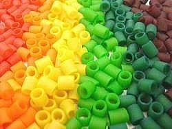 DIY Colored Macaroni Necklaces for kids!!!! Dye pasta with vinegar and food coloring to make cute kids necklaces and bracelets. Kids will love it!