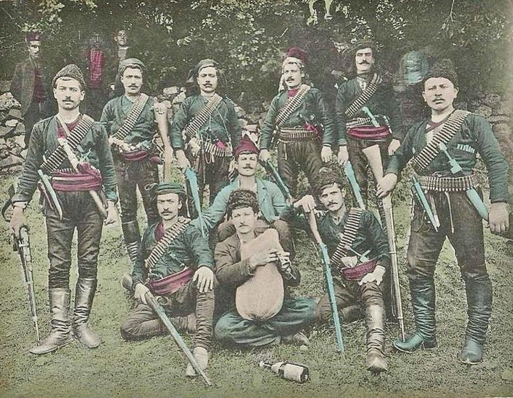 A group of Laz militia, from the coastal areas of the Pazar & Hopa districts (Rize & Artvin provinces). Late-Ottoman era, early 20th century. In their center: a musician holding a 'tulum' (local bagpipes). From a 'Souvenir de Samsoun' postcard.  The Laz (or Lazi) are a Kartvelian-speaking ethnic group native to the Black Sea coastal regions of Turkey and Georgia,  with the majority living in northeast Turkey. The Laz speak the Laz language, a member of the Kartvelian (South Caucasian)…