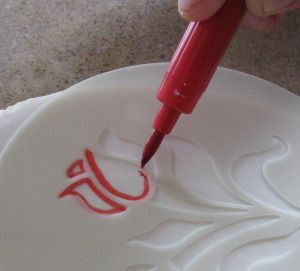 using stencils to do art on your dishes that you make permanent and washable designs with!