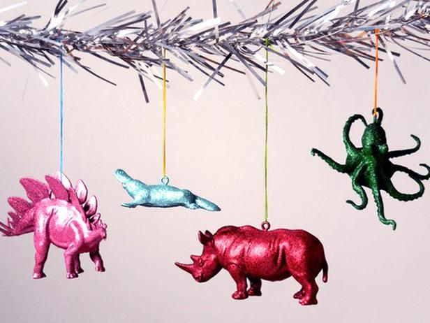 DIY Midcentury Modern Christmas Ornaments by diynetwork: Recycle old plastic toy animals or buy new ones to create a Christmas menagerie. These are so easy to make, the kids can help! #DIY #Christmas_Ornaments #Upcycled_Toy_Animals