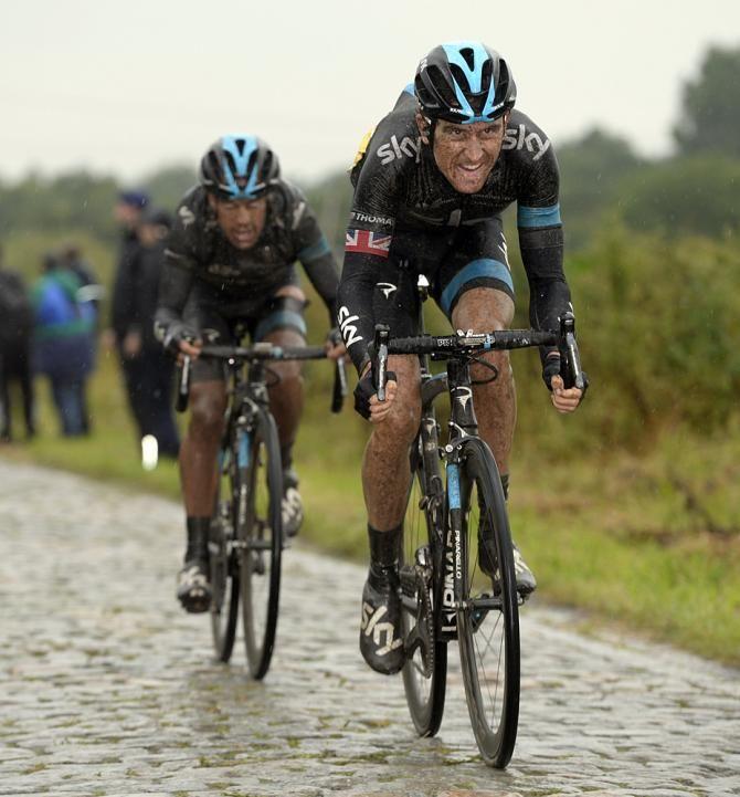 Tour de France 2014 - Stage 5: Ypres - Arenberg Porte du Hainaut 155.5km photos - Geraint Thomas (Sky) leads Richie Porte across the cobbles Photo credit © Bettini Photo