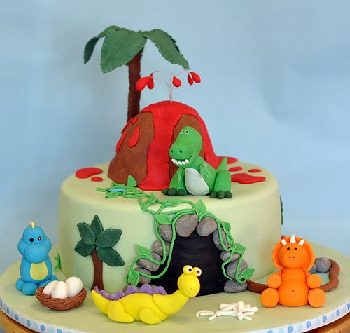 https://flic.kr/p/9eqTsg | Dinosaur Cake | 9 inch chocolate mud cake with dark chocolate ganache. The volcano was also made from cake. The dinosaurs were modeled based on my daughter's bath toys =)