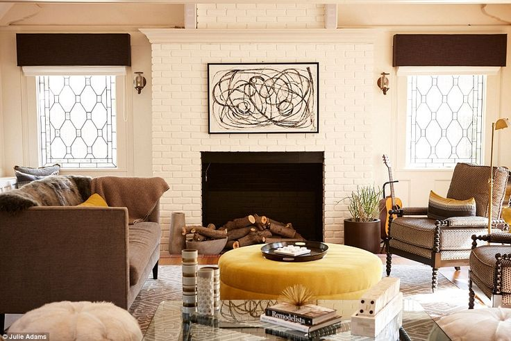 Unique: A living and entertainment area features brown retro style armchairs teamed with c...