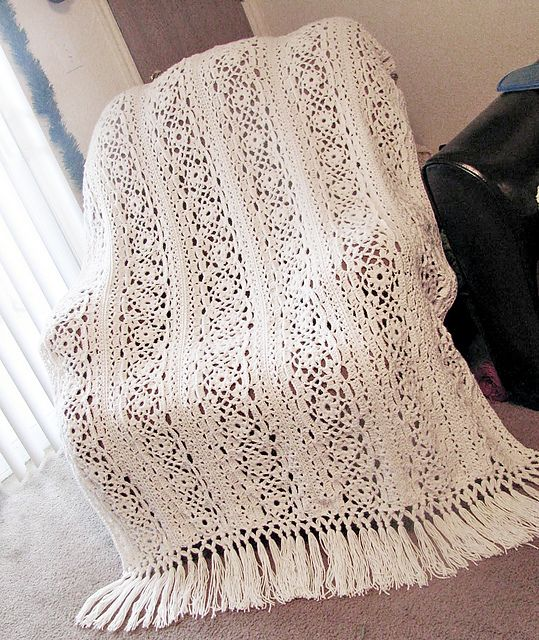 "Irish Lace Blanket, free pattern by Patons.  56"" x 64""; 3,120 yds yarn, hook size 'J'.  This is made with simple squares that are joined to make long panels; panels are then joined. It looks a lot more complicated than it really is after studying the pattern. Pic from Ravelry Project Gallery, some really nice examples there. ~ free pattern ᛡ #IrishCrochetPatterns"