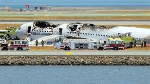 Newly released videos obtained by CBS News suggest that the 16-year-old girl who was run over by a fire truck and killed after surviving a crash on ill-fated Asiana Airlines Flight 214 might have been visible to rescue workers, contradicting earlier reports that she was covered with fire-extinguishing foam.