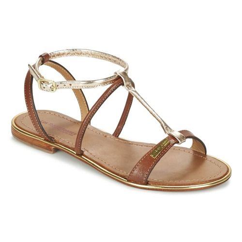 Cette sandale Les Tropéziennes par M Belarbi de couleur marron et dorée est idéale pour se prélasser tout au long de l'été, que ce soit à la terrasse d'un café ou en bord de mer. Munie de brides en cuir et d'une semelle en cuir, la Haquina saura rapidement devenir votre alliée du quotidien.  Stylée et confortable, elle ne demande qu'à être essayée ! - Couleur : Tan / Or - Chaussures Femme 65,00 €