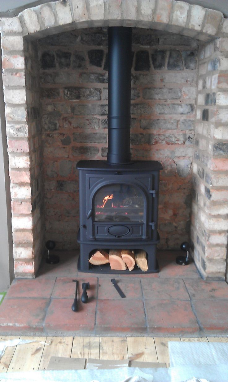 A Stovax Stockton 5 Midline stove shown into an existing fireplace/builder's opening and reclaimed quarry tile hearth. Another great Hagley Stoves installation !