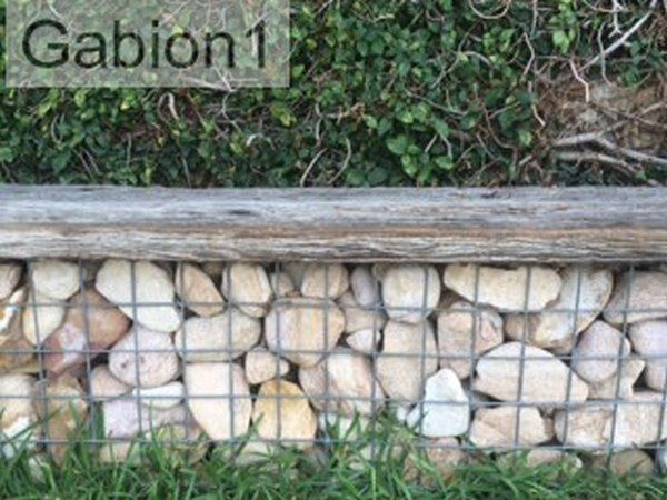 small gabion retaining wall with old timber seat on top