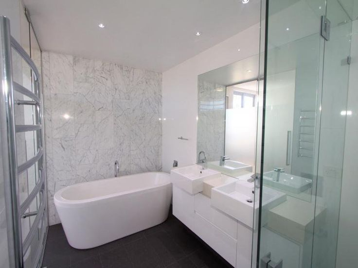 Black floor tiles white grey marble feature wall tiles white vanity bathroom ideas Freestanding bathtub bathroom design