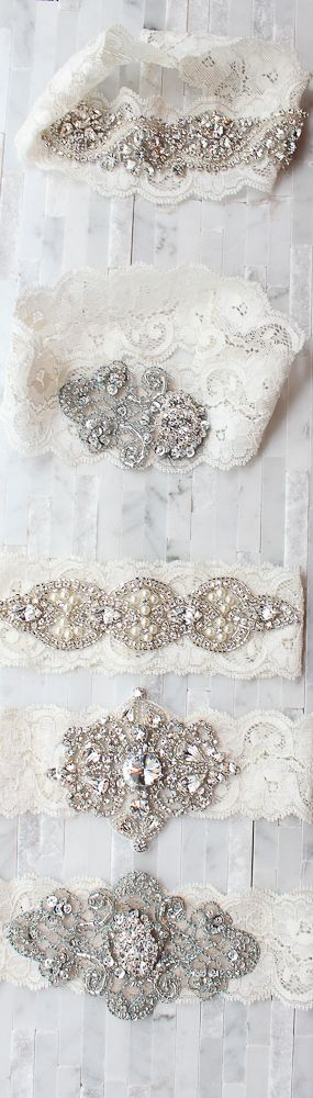 Hand picked crystal bridal buttons and brooches adorned on vintage inspired blue beaded trimmings layered on French imported lace. Comes with matching toss. By Emily Riggs Bridal