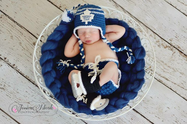 SCORE!!! Super adorbs Toronto Maple Leafs crochet hocket set  Wool roving big braid basket stuffer and crochet newborn hockey skates, TML hat and hockey pants diaper cover by:  www.facebook.com/thatsoffthehook