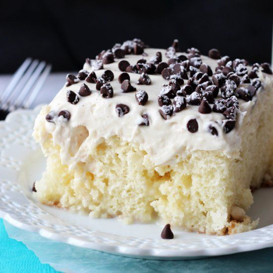 Cannoli Poke Cake - vanilla cake soaked with sweetened condensed milk, topped with a delicious cannoli filling topping!