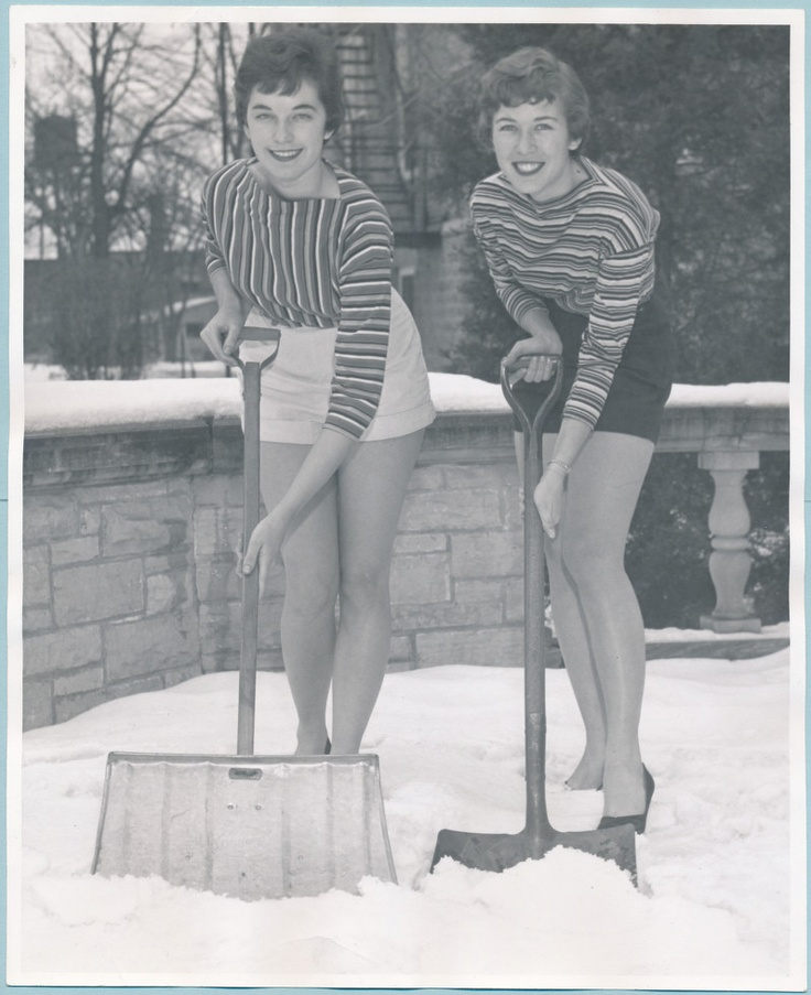 """Two students shoveling snow in shorts for Ripon College's """"Help Week,"""" 1956. From Ripon College Archives."""