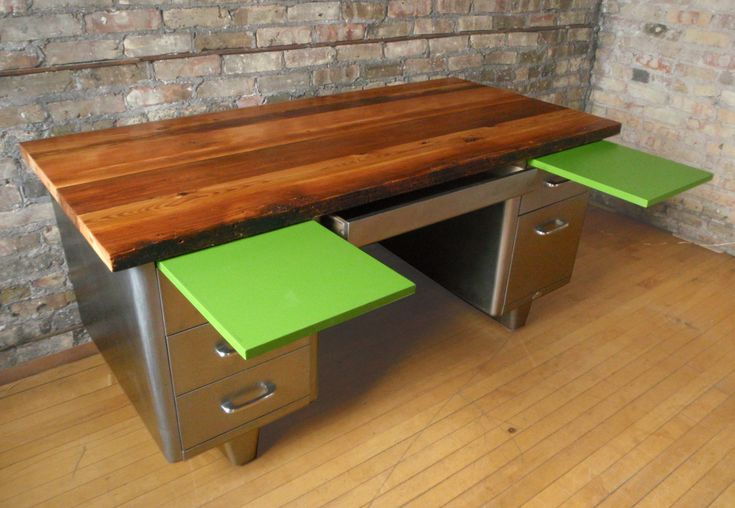 Old, warm wood and cool steel come together in this refurbished 50's All Steel desk. The reclaimed Douglas fir planks are held together using a cherry spine set into a consistent 1/2″ d…