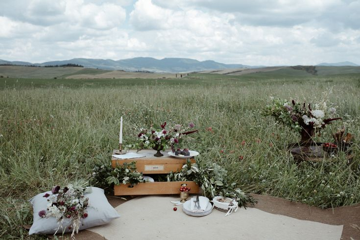 An antique travel chest and  iron support for flower centerpieces
