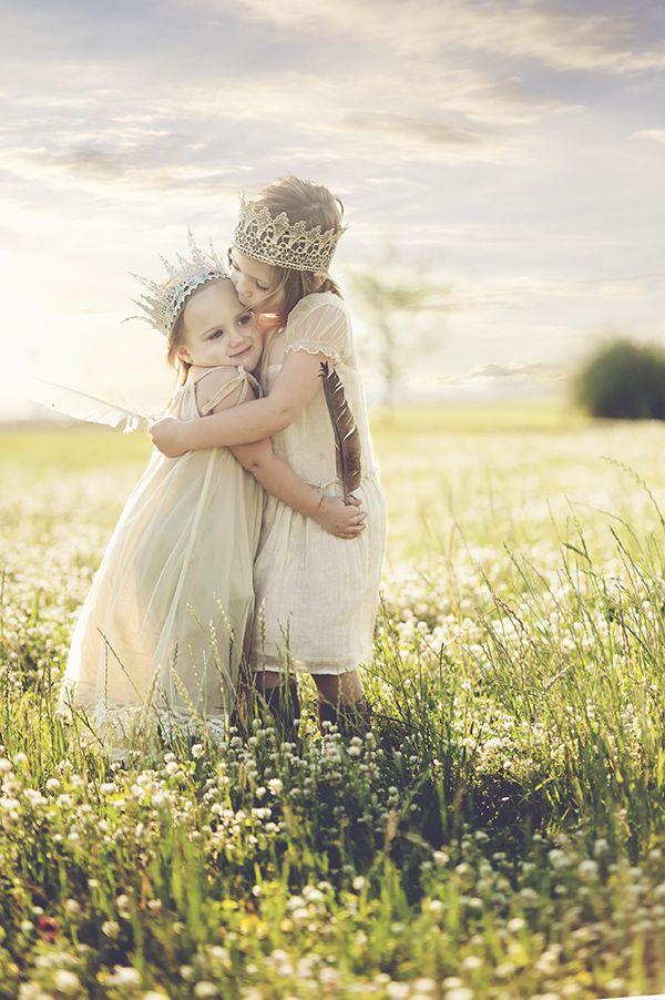 Look at that beautiful photo with beautiful crowns and feathers.  Love it! I see this in my future with two sweet girls!
