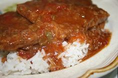 Creole Smothered Steak - cube steaks or tenderized round steak in a nicely seasoned Creole sauce of tomatoes, onions and peppers with rosemary and thyme. This recipe does well in a slow cooker when using round steak.