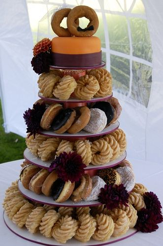donut wedding cake. check out the details on the top two! so cute for a non-traditional cake <3 morning after Batch party? Or perhaps at a bridal shower brunch? --- LOVE this cake! I mean, I wouldn't want it to replace the cake for cutting, but maybe there's another time and place? I just love doughnuts and the top two are so cute!!