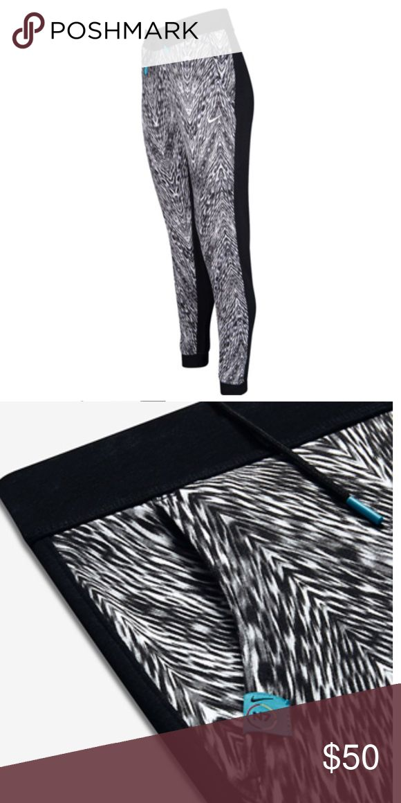 "Nike N7 Casual Printed Pants - Sweatpants Nike New Sportswear N7 Casual Printed Women's Pants - Sweatpants Style# 834498 The perfect blend of sporty style and comfort. French terry fabric provides a soft, lightweight feel. Elastic waistband with drawcord for a personalized fit. Hand pockets. Tight fit is cut slim through the entire leg. Ribbed cuffs . 52% cotton/29% polyester/19% rayon.. Machine wash Measurements approx. taken on Pants laid flat: Size (M) - 30"" waist, 40"" length, 30"" inseam…"