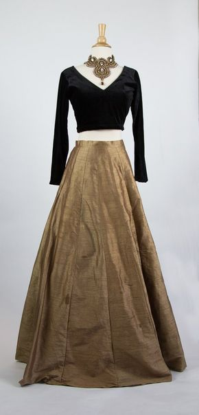 Raw silk bronze coloured lengha with cotton lining. Tulle underneath the skirt to give a more flared appearance.