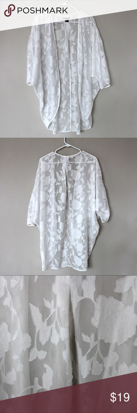 CLOSET CLOSING! Bohemian White Floral Lace Kimono CLOSET CLOSING 4/28/2017  BUY OR MAKE AN OFFER!  🔷Chelsea & Theodore Flowing Kimono 🔹White Floral Lace Appliques 🔹Size S 🔹100% polyester. 🔹Machine Wash, Tumble Dry  Super Romantic, Bohemian Kimono. Perfect for lazy lounges or sexy nights out. Only worn a handful of times. The model picture is to show how it fits. There is a mark on the inside of the kimono that can't be seen from the outside, as shown in the close up. Chelsea & Theodore…