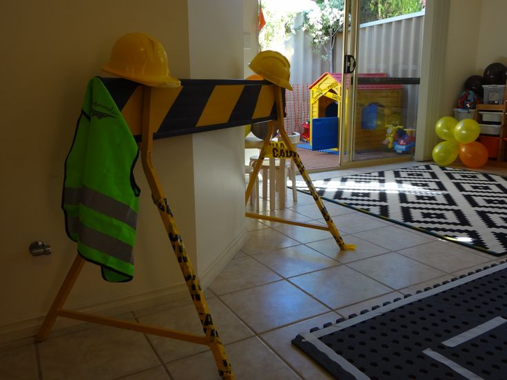 Digger décor. I purchased hard hats for the kids from a $2 shop. However two year olds aren't that keen on keeping a hat on! The party boy wore a fluorescent vest.