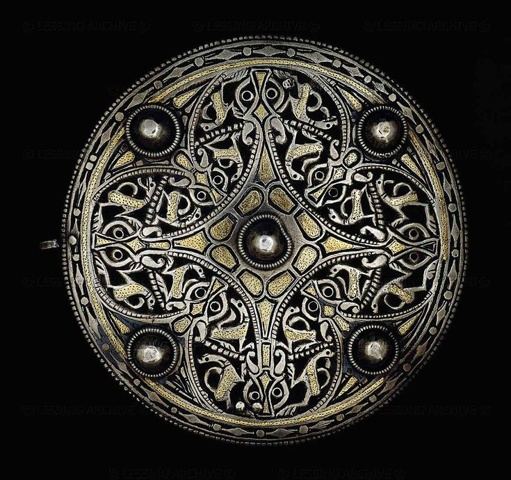 The Strickland Brooch, Anglo-Saxon, mid-9th century. Plain gold panels enrich a lively pattern of dog-like animals with collars, deeply carved to form an openwork effect.