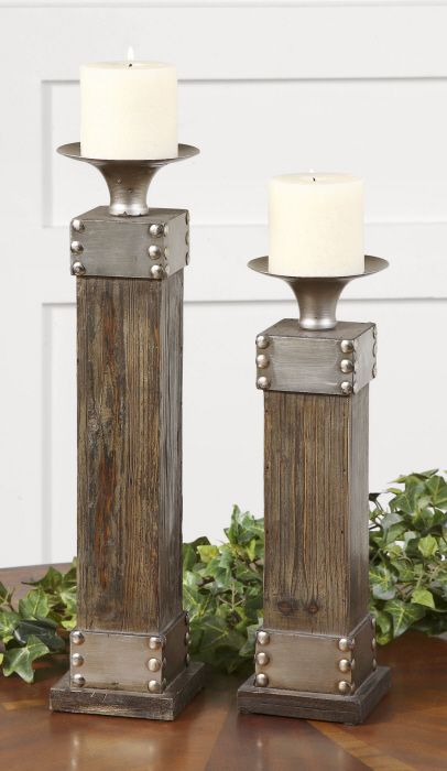 Uttermost Lican Natural Wood Candleholders. Natural wood with a light chestnut stain and antiqued silver accents. Distressed white candle included. Sizes: Sm-5x14x5, Lg-5x18x5.