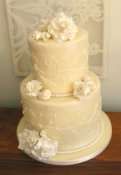 Ivory and cream sugar roses on a small wedding cake at the National Arts Centre