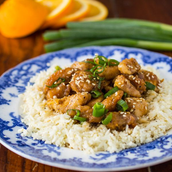 "This Paleo Orange Chicken is lightly coated with tapioca flour, and oven ""fried"". Serve it over Cauliflower Rice as a great grain free alternative to Chinese takeout."