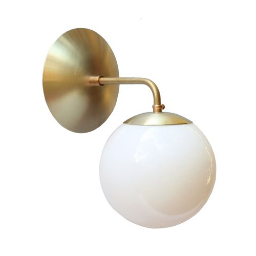 "AltoSconceBrassOPs.jpg  Iconic midcentury reissued.  Authentic profiles made in brass exclusively for Cedar & Moss.  6"" Hand-blown glass shade included, light bulb sold separately  Depth 8.5""  Length 10.5""  Width 6""  Max Wattage: 60  UL Listed  Candelabra Socket"