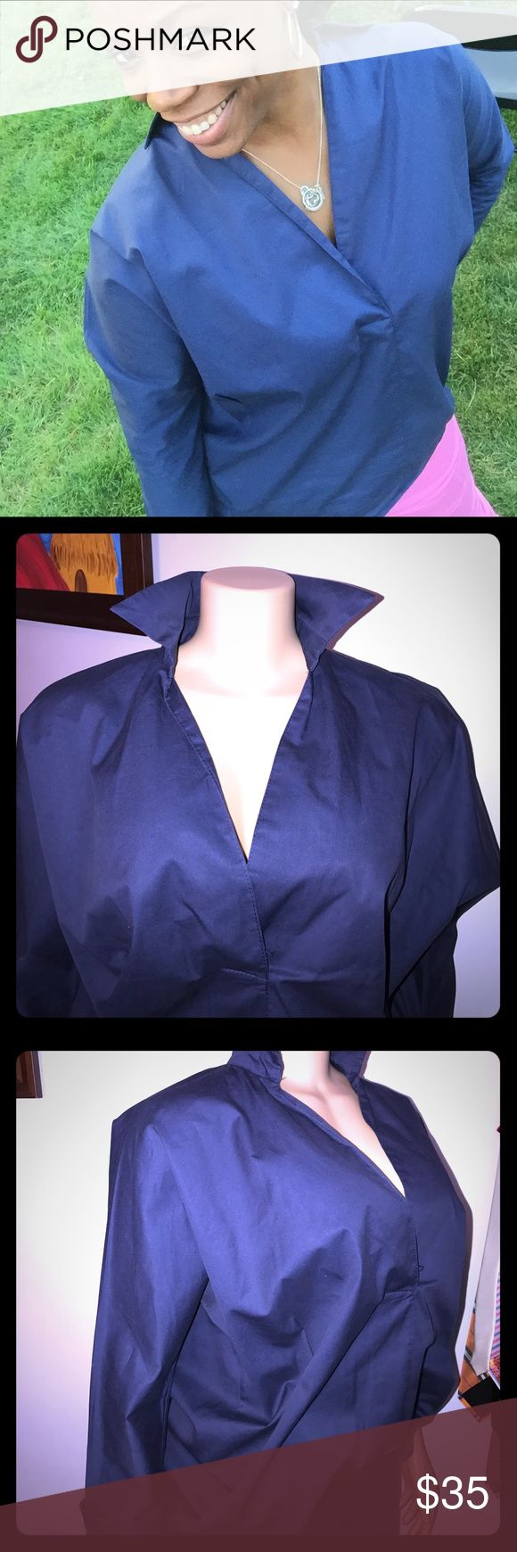 Beautiful Couture Tailored Shirt Available in Navy and White! Dress up or down. 100% cotton. 26 inch bust. (Oversized look) 26 inch long with high low bottom. Buttons in back but fits over head. Tag says large but fits like a oversized small. Excellent condition. Boutique Tops Button Down Shirts