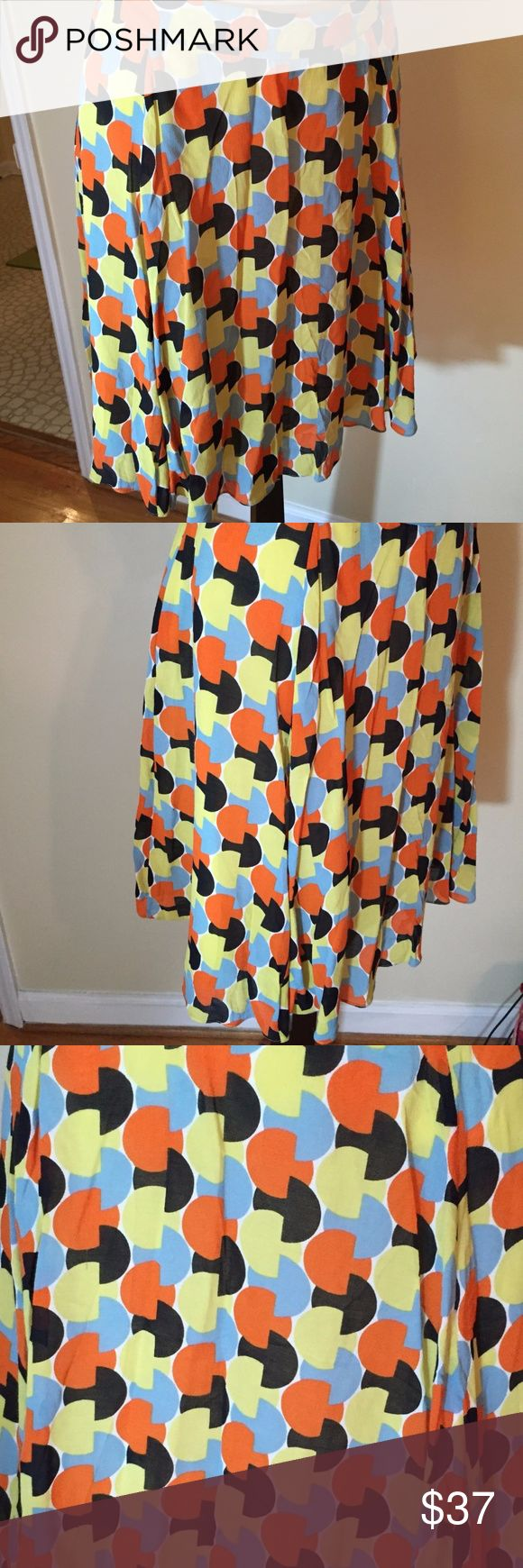 """Semantiks L Silk Graphic Print Orange Blue & Brown Great skirt from Sematiks (Nordstrom) in a graphic mod print of acid yellow, coral, robins egg blue, and chocolate brown. Relaxed a-line (almost circle) skirt has a 1.5"""" wide waistband. Fully lined.  BRAND:  SEMANTIKS STYLE:  Above the knee, full.  MEASUREMENTS. The skirt is a size L. Measurements are taken with item laying flat.            WAIST:      38"""" HIPS:         +46"""" LENGTH:  22"""" SWEEP:    +53 (free)  FABRIC. 75% Silk/ 23% Cotton…"""