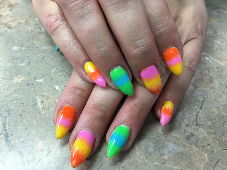 Bright candy corn gel nails.