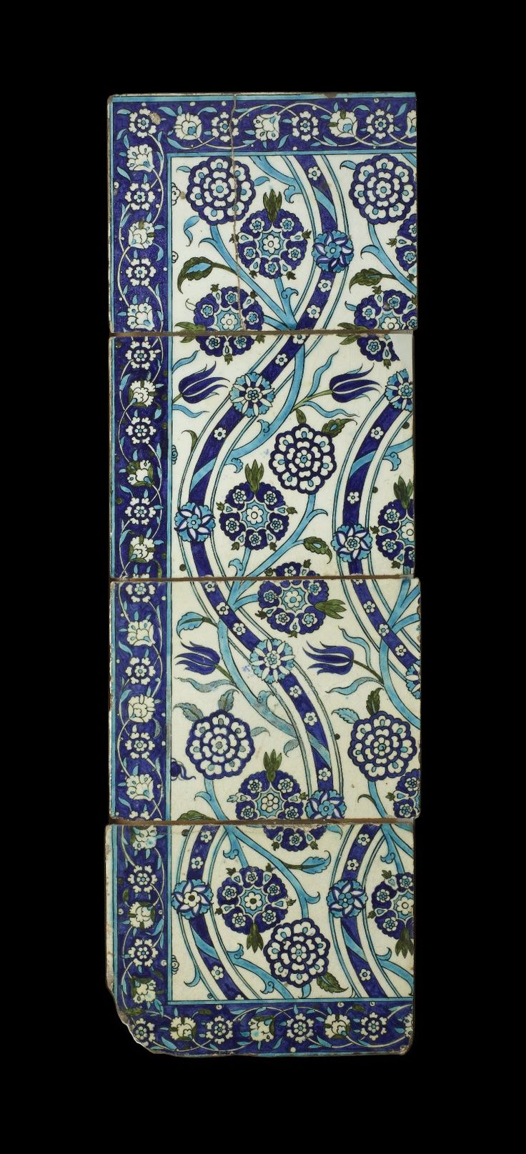 Tile (from panel). Parallel undulating stems, prunus blossoms or larger composite flowers, leafy tufts or three-pronged tulips, scrolls. Made of black, turquoise, cobalt, green painted and glazed and bevelled and stencilled ceramic, pottery.tile; Ottoman dynasty; 16thC; Iznik